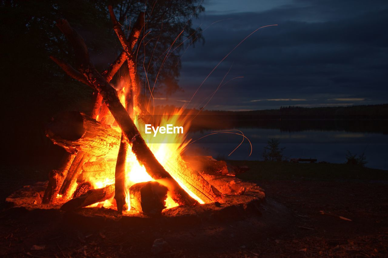 burning, heat - temperature, fire, flame, fire - natural phenomenon, nature, night, orange color, land, glowing, wood, bonfire, motion, sky, environment, log, no people, tree, outdoors, firewood, campfire