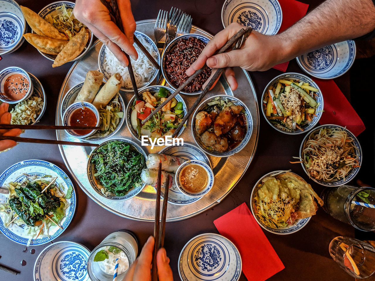 food and drink, food, table, human hand, hand, freshness, ready-to-eat, plate, healthy eating, bowl, choice, indoors, high angle view, wellbeing, real people, variation, asian food, chopsticks, eating utensil, kitchen utensil, chinese food, finger