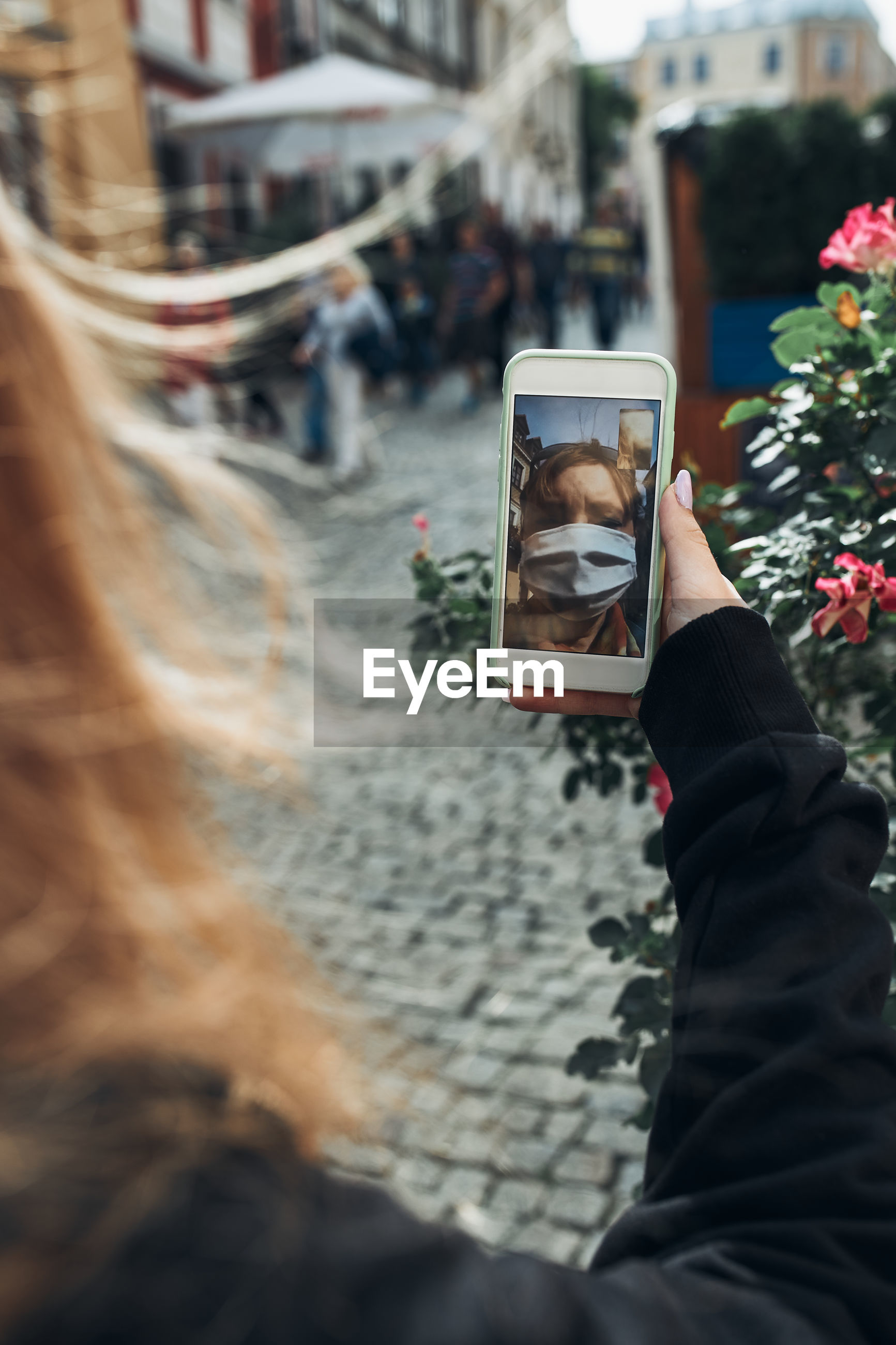 Close-up of woman video calling while standing outdoors