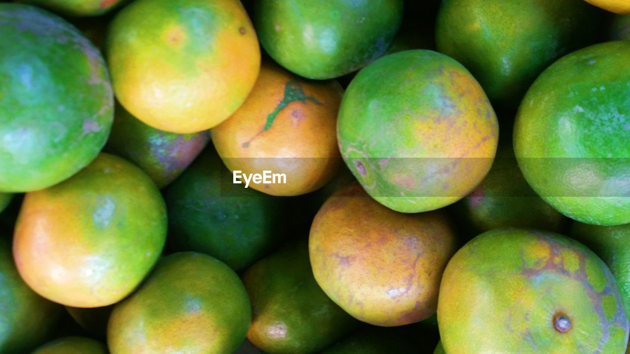 fruit, healthy eating, food and drink, food, green color, large group of objects, freshness, no people, abundance, close-up, mango, market, day, backgrounds, outdoors