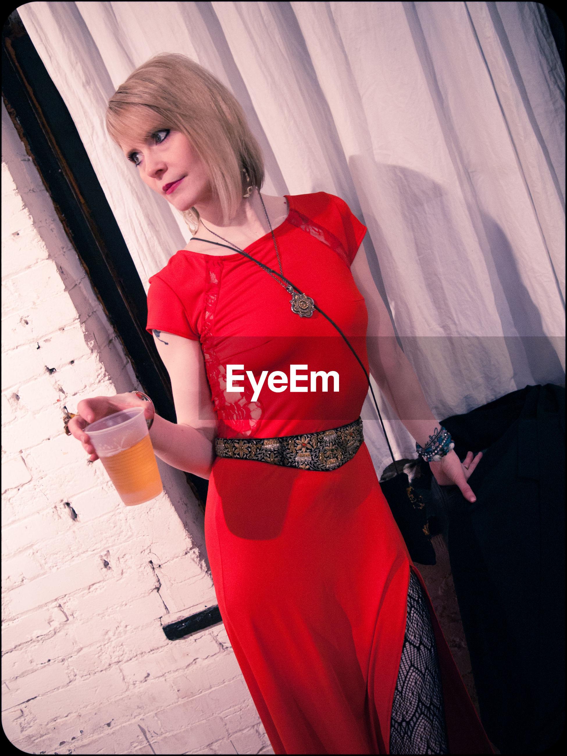 PORTRAIT OF WOMAN IN RED DRESS
