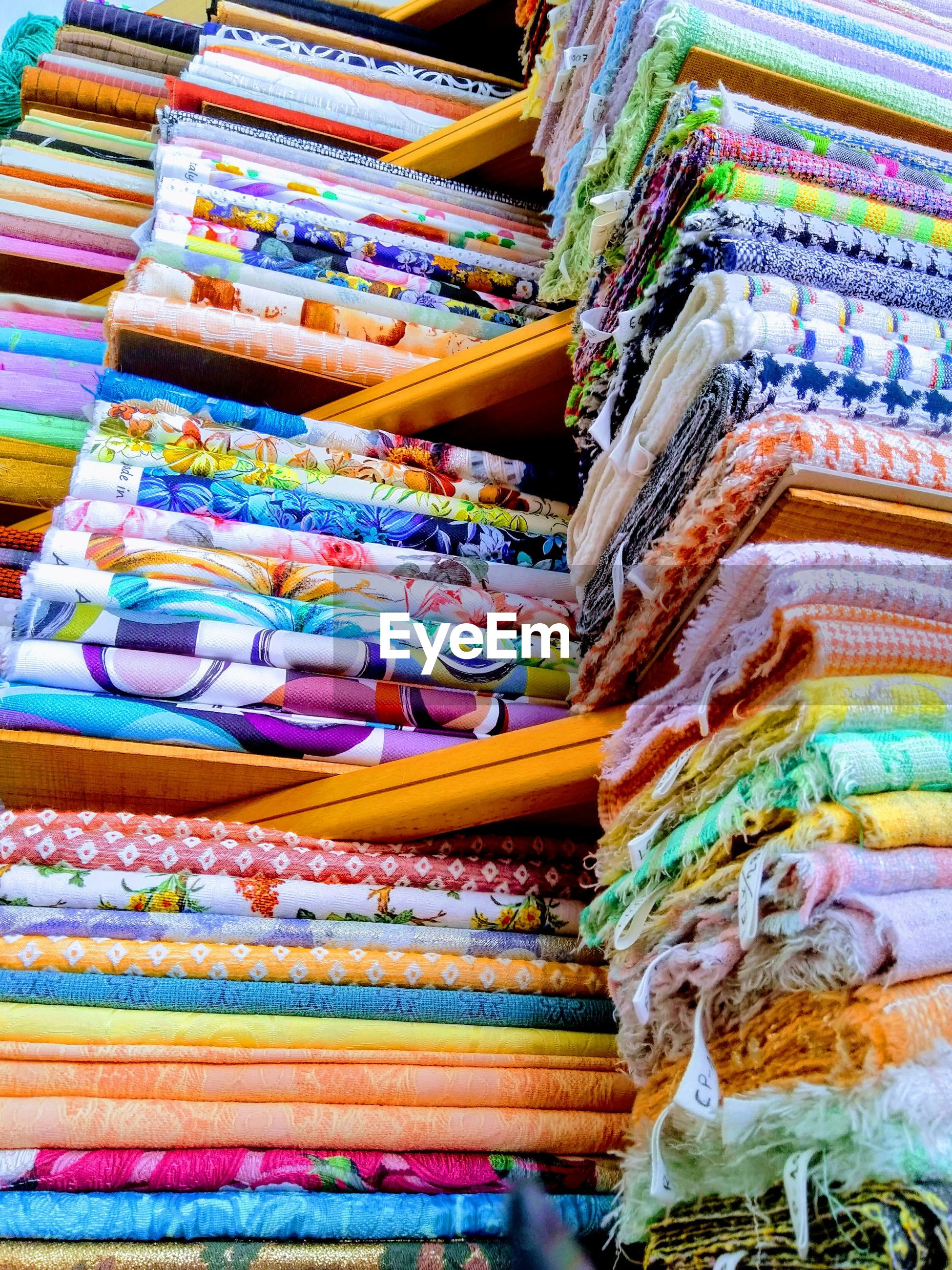 High angle view of multi colored fabric on store