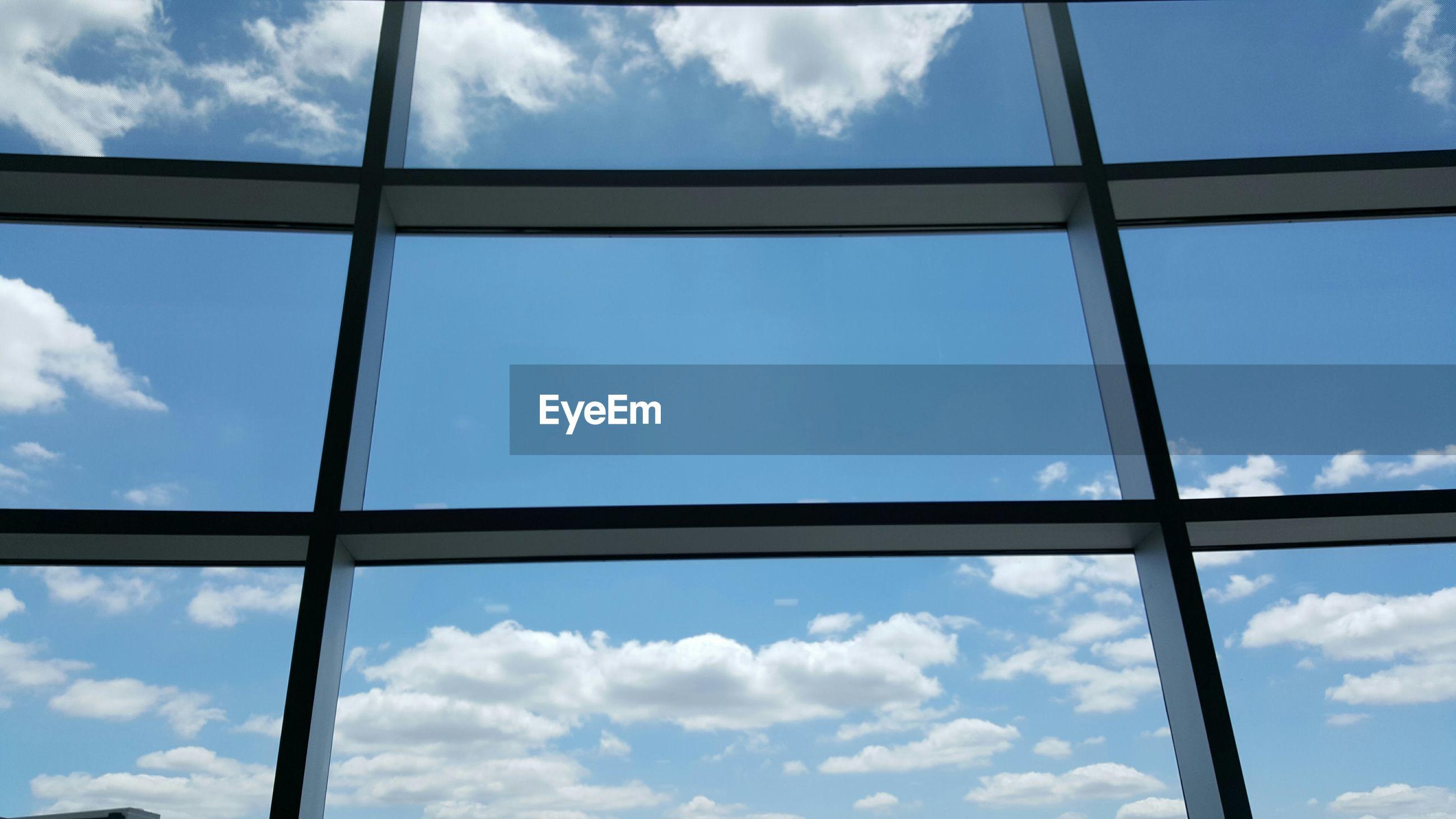 Cloudy sky viewed through window