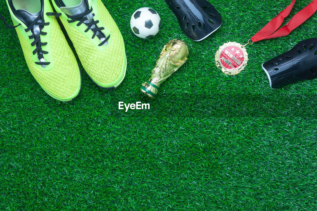 Directly above shot of sports equipment on grass