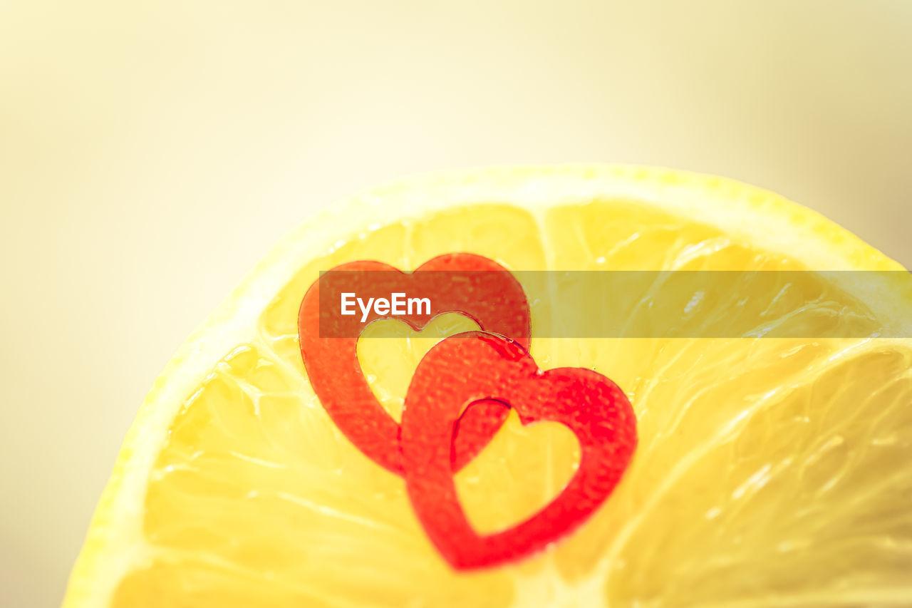 Close-up of heart shapes on lemon