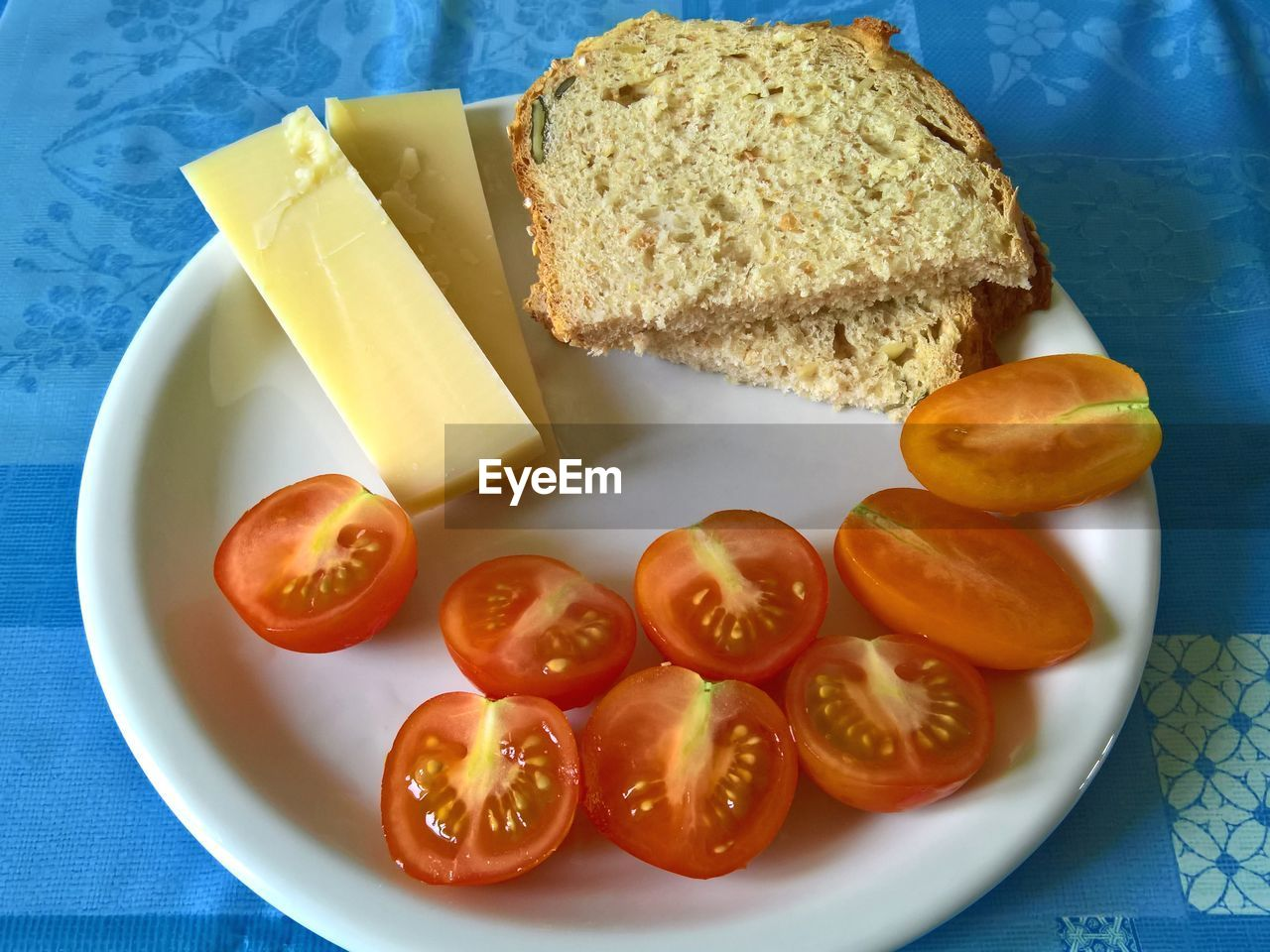 food, food and drink, bread, healthy eating, plate, freshness, wellbeing, still life, fruit, indoors, slice, tomato, no people, table, ready-to-eat, high angle view, dairy product, meal, vegetable, breakfast, snack