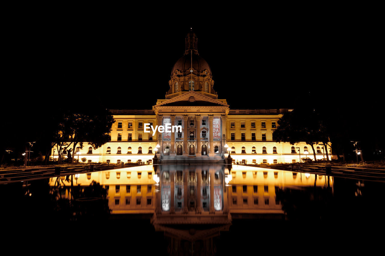building exterior, illuminated, architecture, built structure, night, travel destinations, sky, water, tourism, city, no people, reflection, travel, nature, waterfront, history, the past, facade, government, spire
