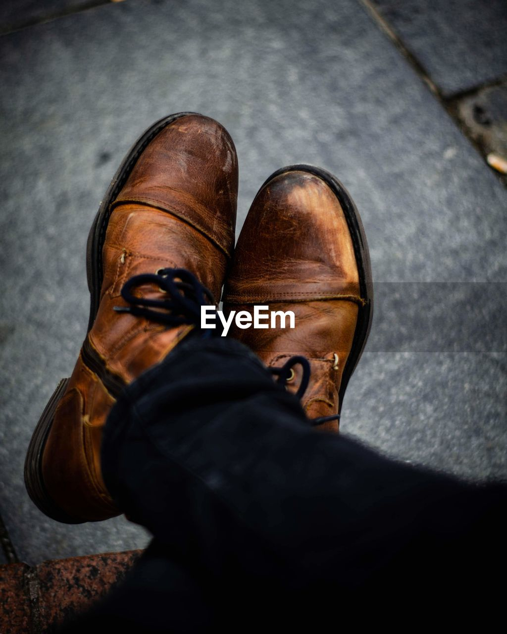shoe, low section, real people, men, human leg, body part, human body part, personal perspective, leather, people, high angle view, two people, lifestyles, standing, leisure activity, day, casual clothing, togetherness, friendship, jeans, human foot, human limb