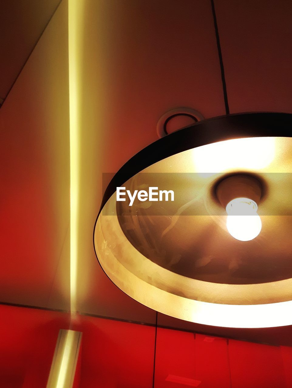 LOW ANGLE VIEW OF ILLUMINATED ELECTRIC LIGHT
