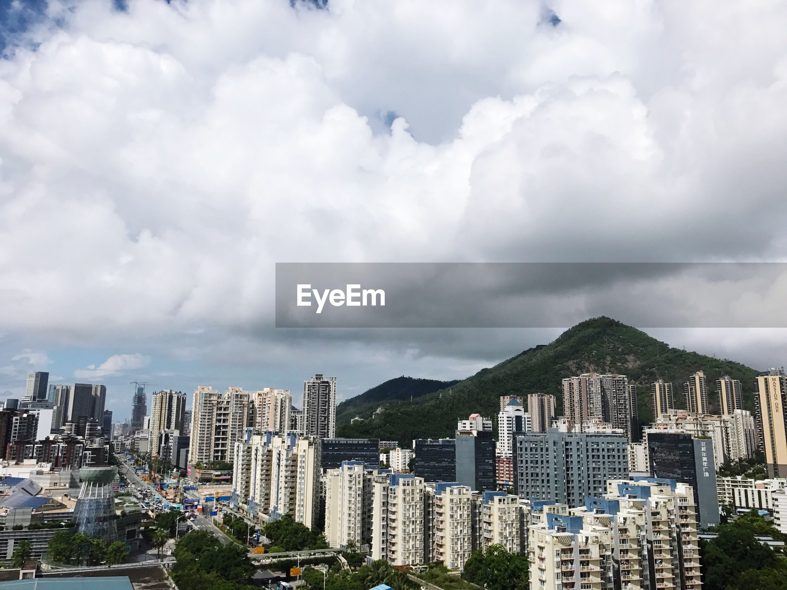 architecture, cityscape, building exterior, built structure, city, skyscraper, cloud - sky, crowded, mountain, sky, day, outdoors, modern, sea, urban skyline, nature