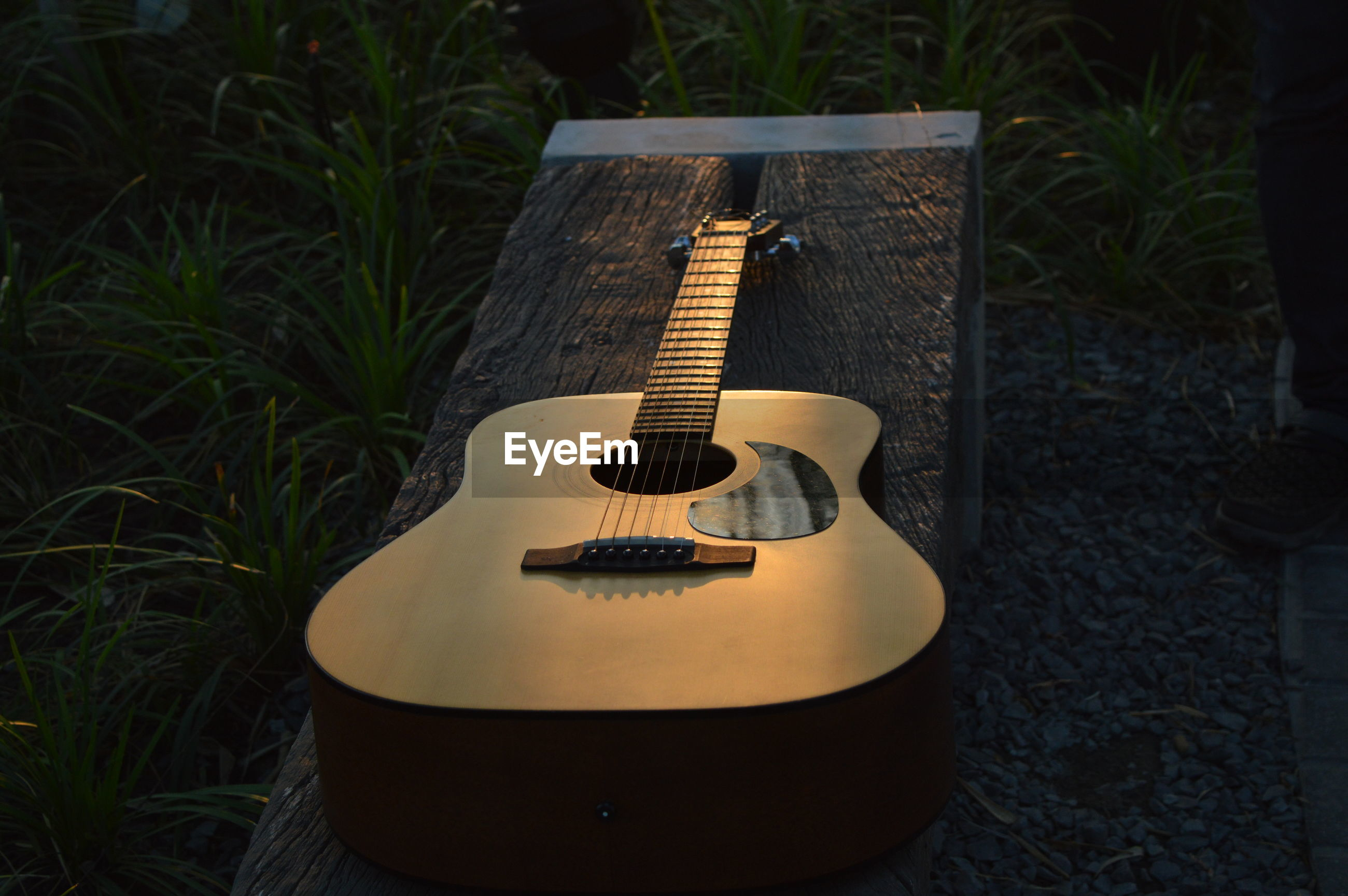 High angle view of guitar on grass