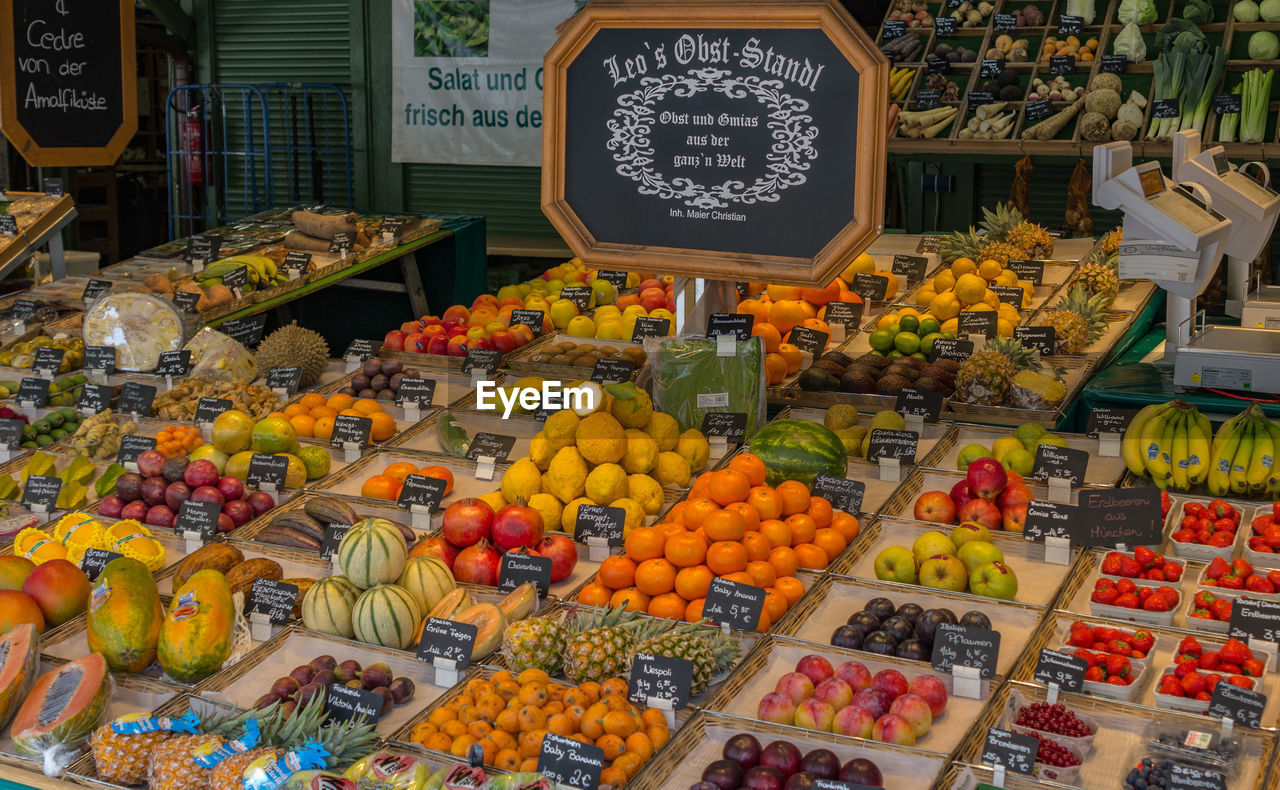 food and drink, food, healthy eating, market, choice, retail, fruit, for sale, variation, wellbeing, market stall, freshness, text, price tag, large group of objects, abundance, communication, script, orange color, non-western script, no people, orange, retail display, sale