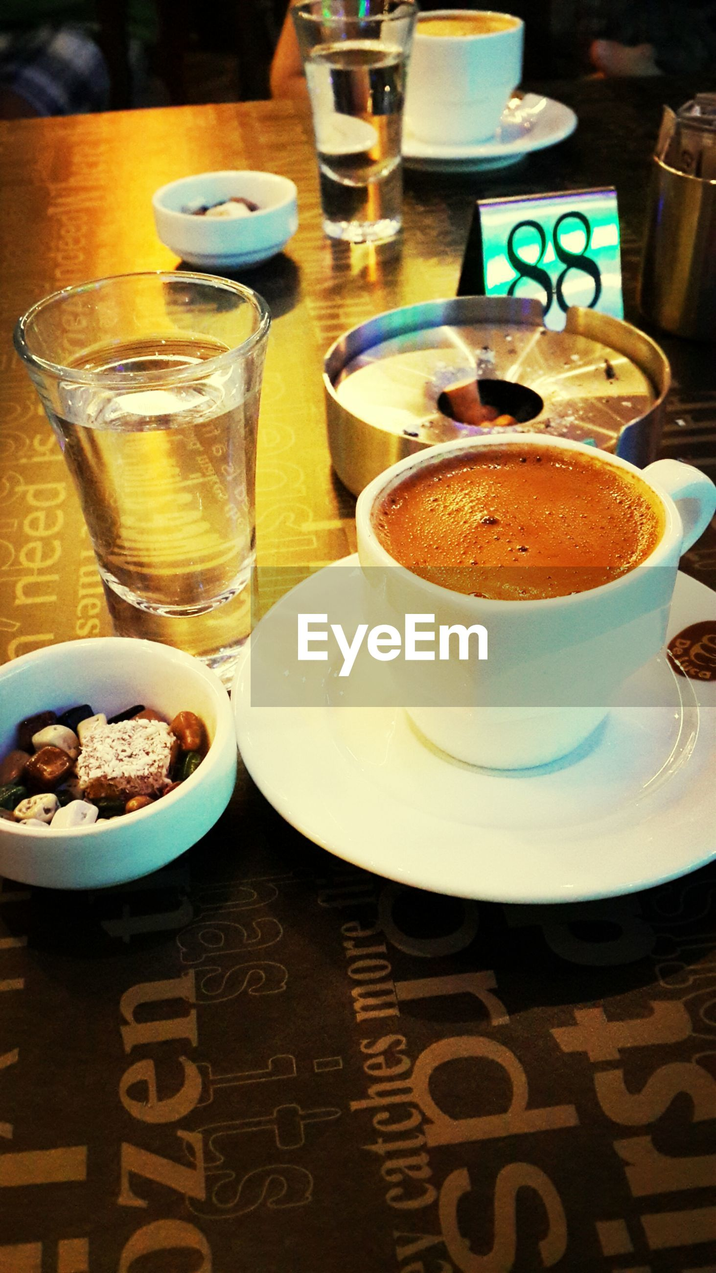 food and drink, indoors, drink, table, refreshment, freshness, still life, coffee cup, coffee - drink, saucer, food, drinking glass, plate, ready-to-eat, high angle view, close-up, cup, sweet food, coffee, serving size