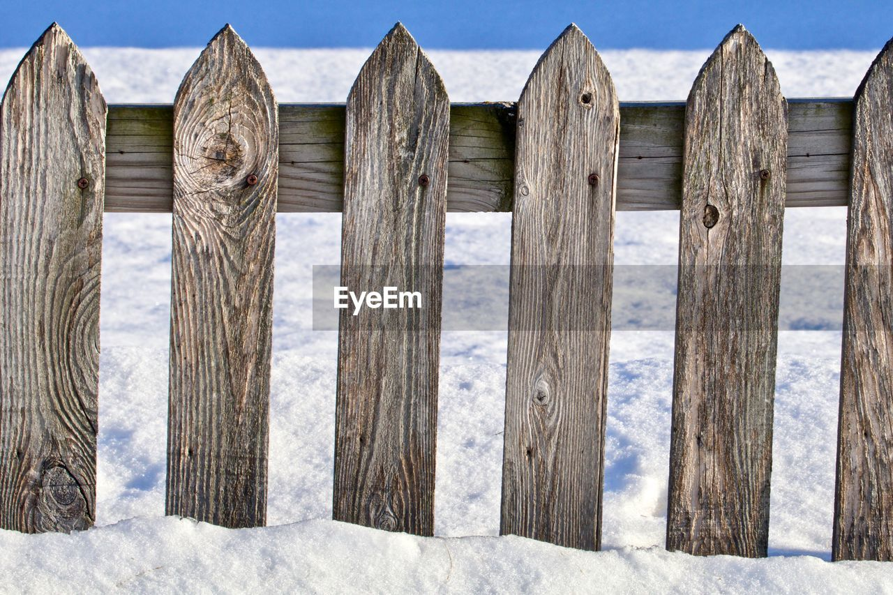 PANORAMIC VIEW OF WOODEN FENCE ON LANDSCAPE AGAINST SKY