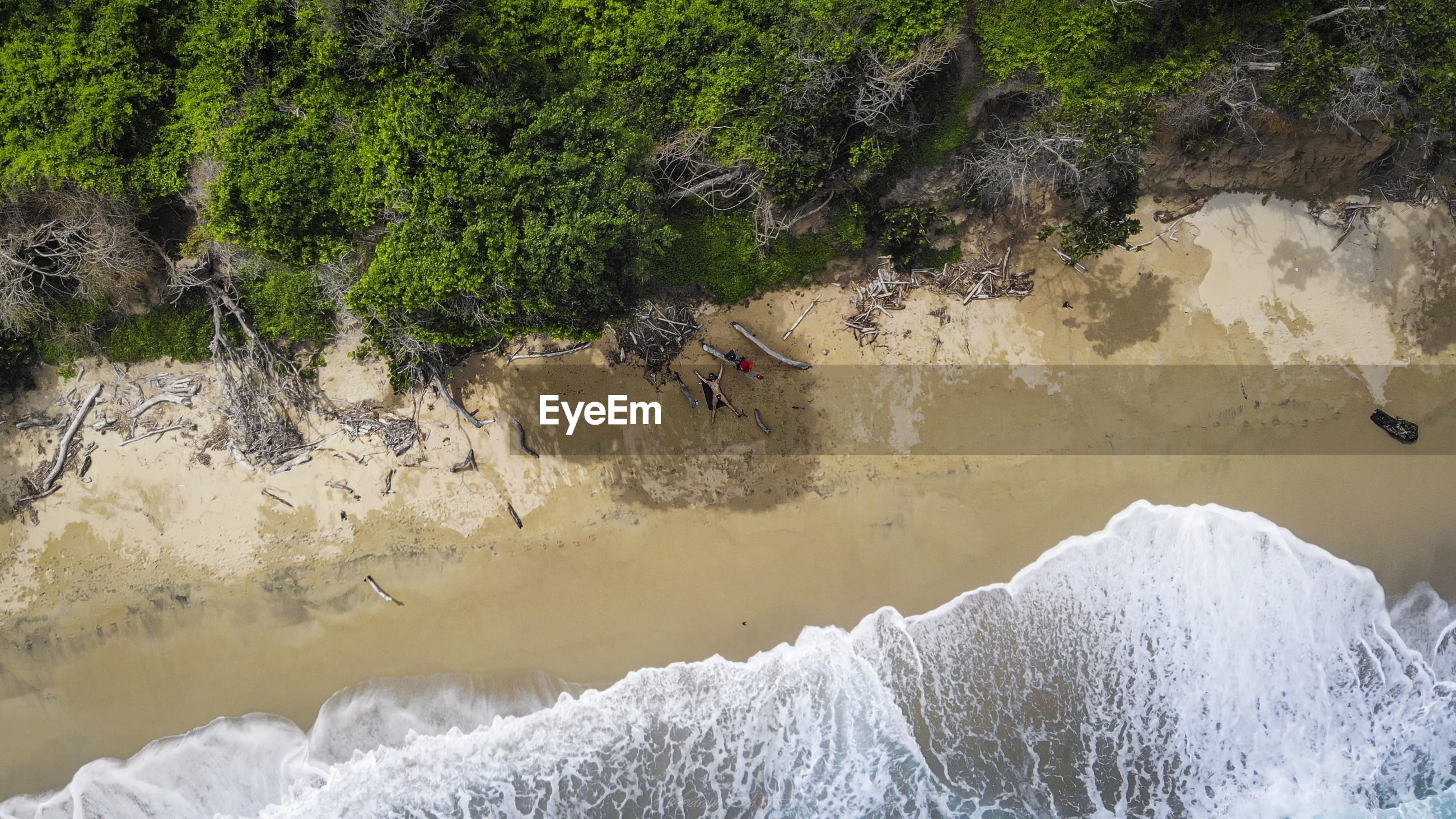 Aerial view of man lying on beach