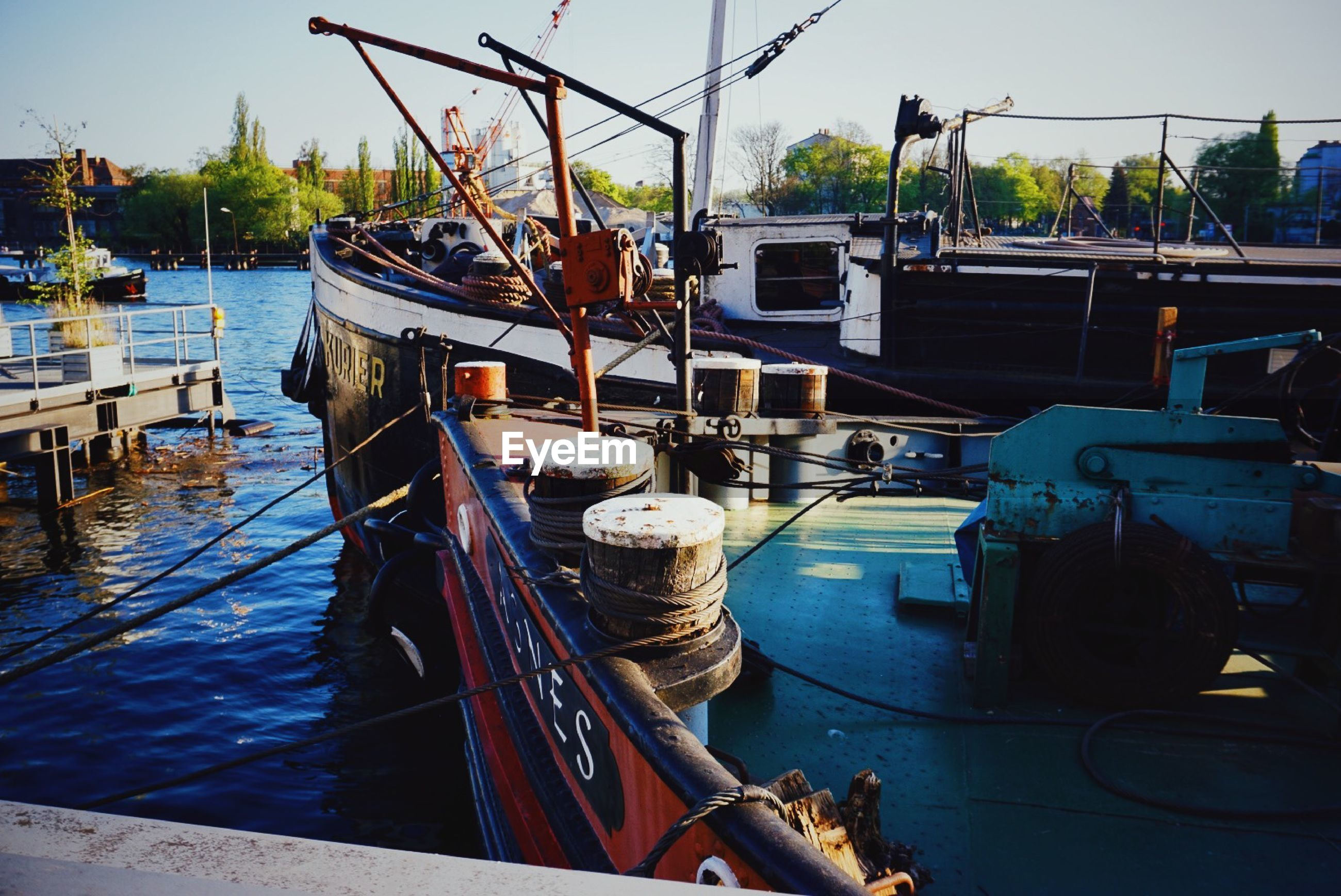 Boats moored at harbor