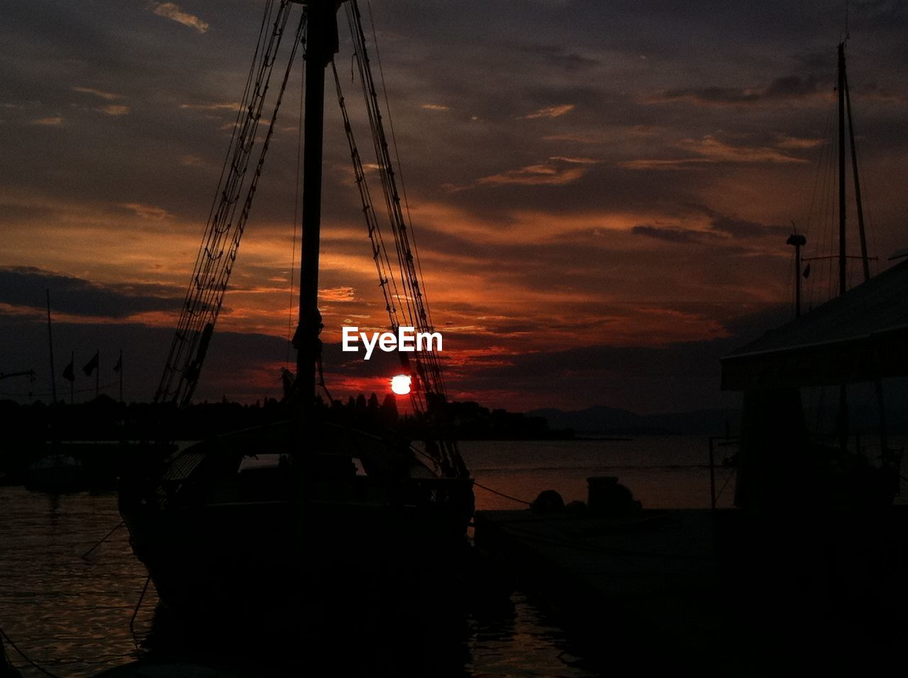 sunset, nautical vessel, sky, cloud - sky, silhouette, mast, water, boat, mode of transport, moored, transportation, harbor, nature, sea, scenics, beauty in nature, outdoors, travel destinations, sailboat, tranquility, no people, yacht, tall ship, sailing ship, day