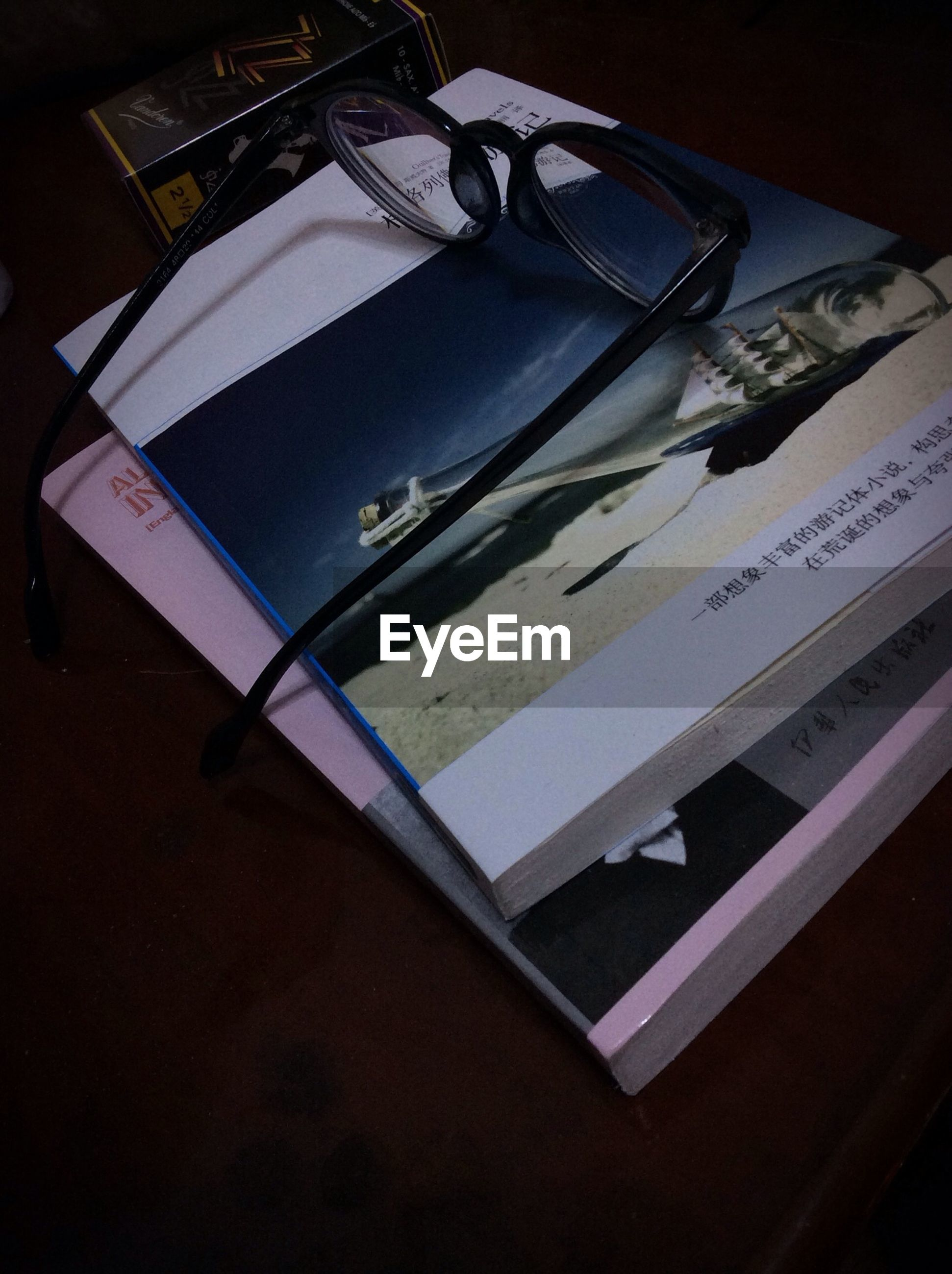 indoors, low angle view, book, table, high angle view, still life, no people, education, tilt, close-up, absence, paper, communication, shadow, text, architecture, open, vignette, built structure, day