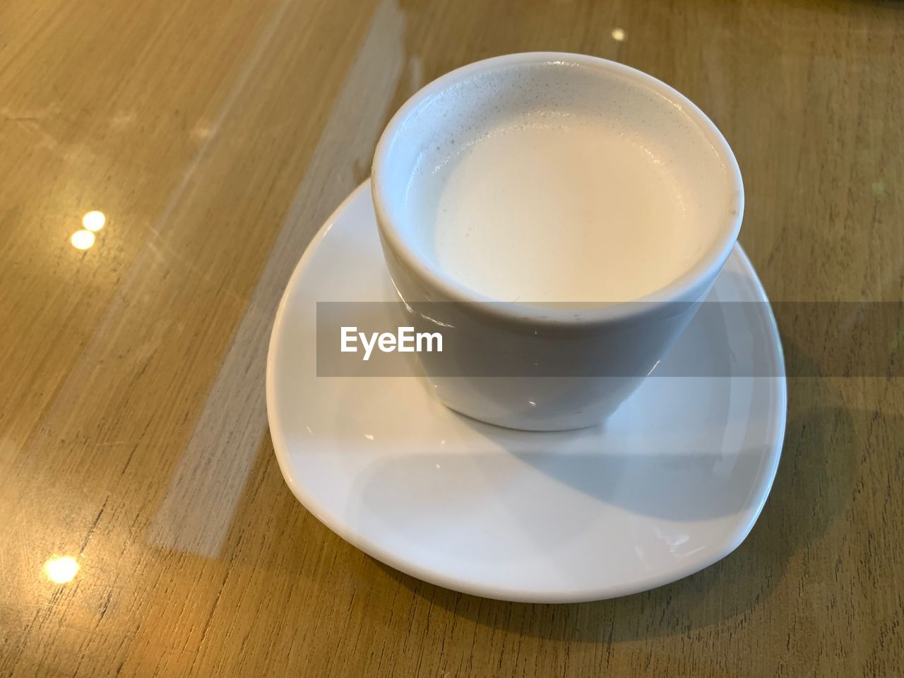 saucer, drink, crockery, refreshment, table, food and drink, cup, coffee cup, still life, coffee, mug, coffee - drink, high angle view, white color, indoors, wood - material, close-up, freshness, no people, frothy drink, non-alcoholic beverage, temptation