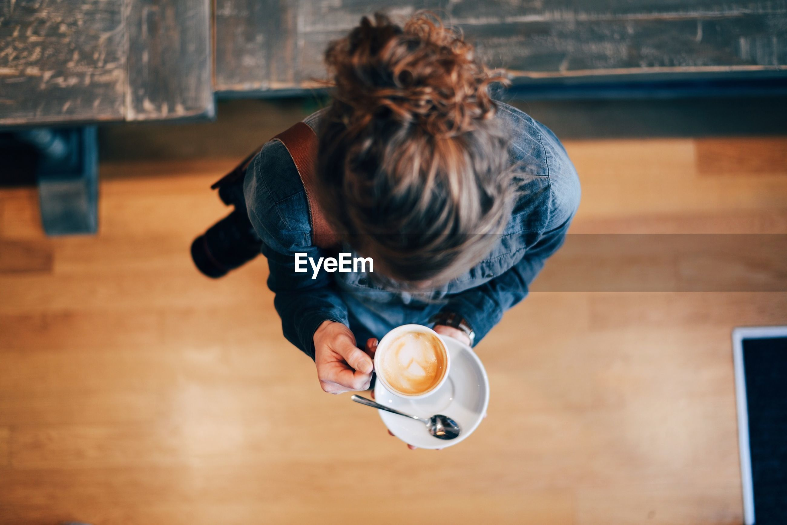 Directly above shot of woman holding cappuccino