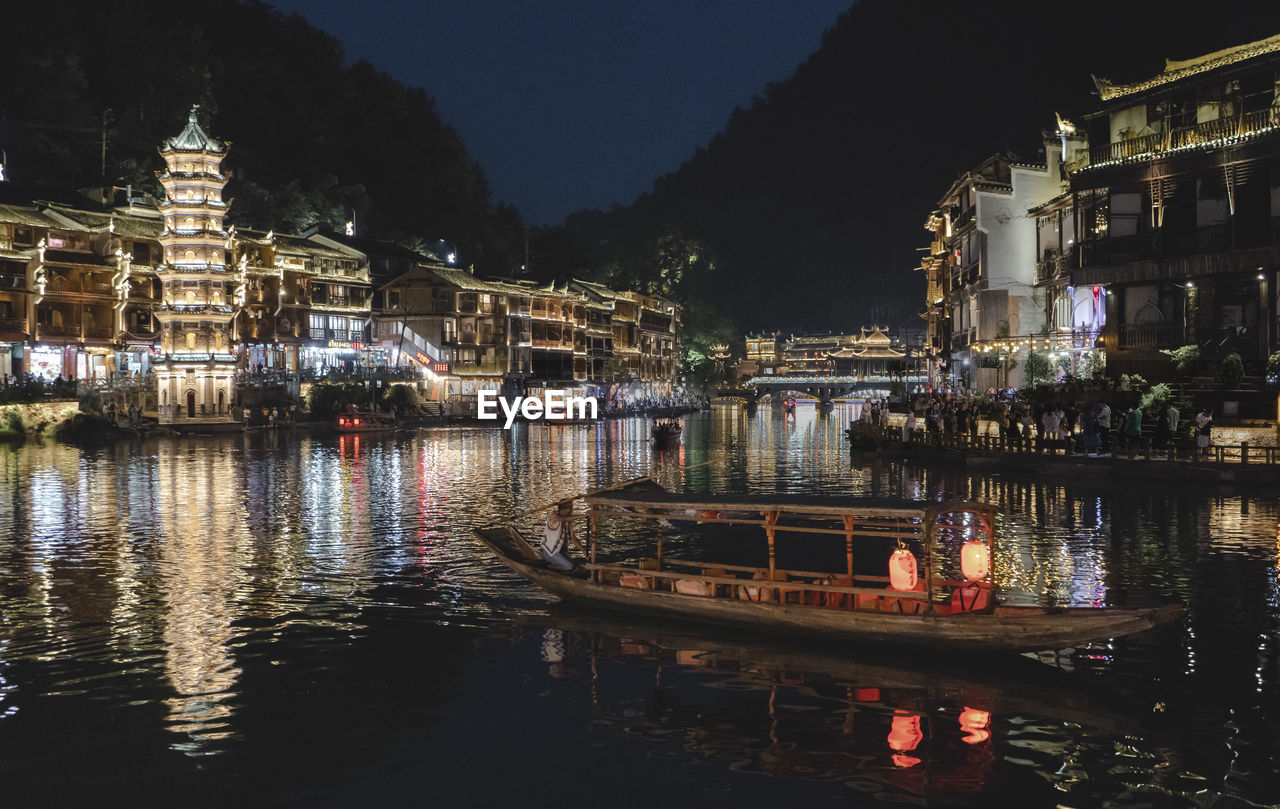 water, building exterior, built structure, architecture, nautical vessel, illuminated, night, reflection, transportation, waterfront, mode of transportation, building, nature, river, city, no people, moored, outdoors, travel, passenger craft