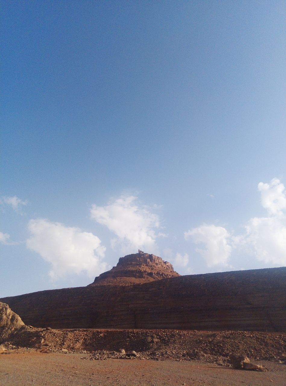sky, environment, cloud - sky, beauty in nature, landscape, scenics - nature, tranquil scene, tranquility, mountain, nature, land, day, non-urban scene, no people, rock, copy space, blue, solid, rock formation, outdoors, formation, arid climate, climate