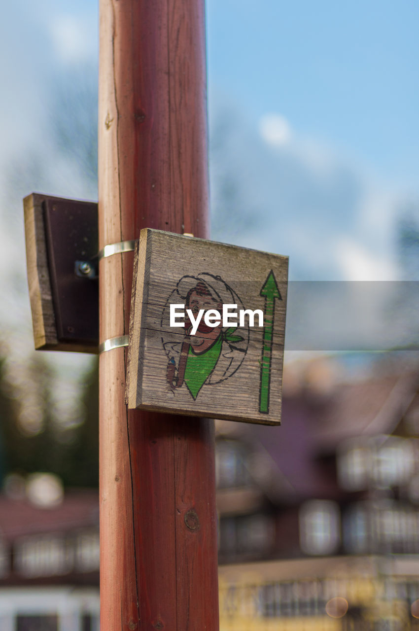 wood - material, focus on foreground, communication, human representation, day, no people, sky, tree, outdoors, close-up, placard