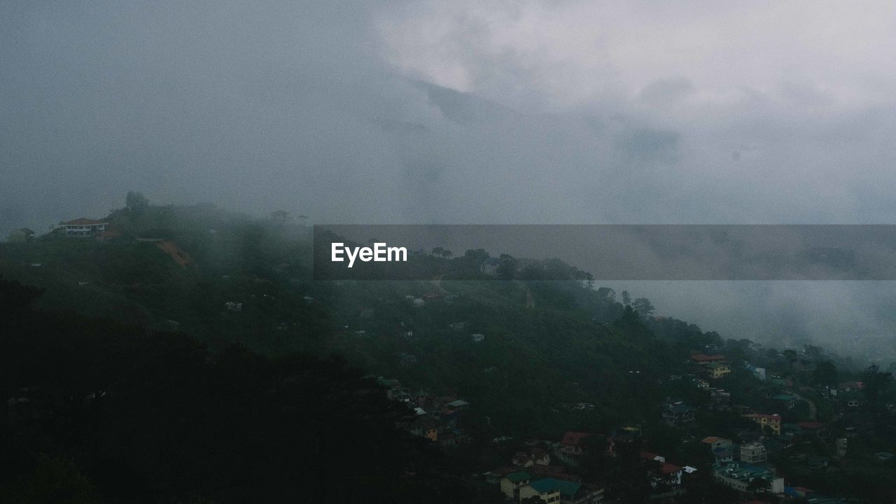 fog, sky, mountain, nature, beauty in nature, environment, people, landscape, outdoors, architecture, storm, forest, cloud - sky, day, travel, scenics - nature, leisure activity, scenery, mountain peak, mountain range