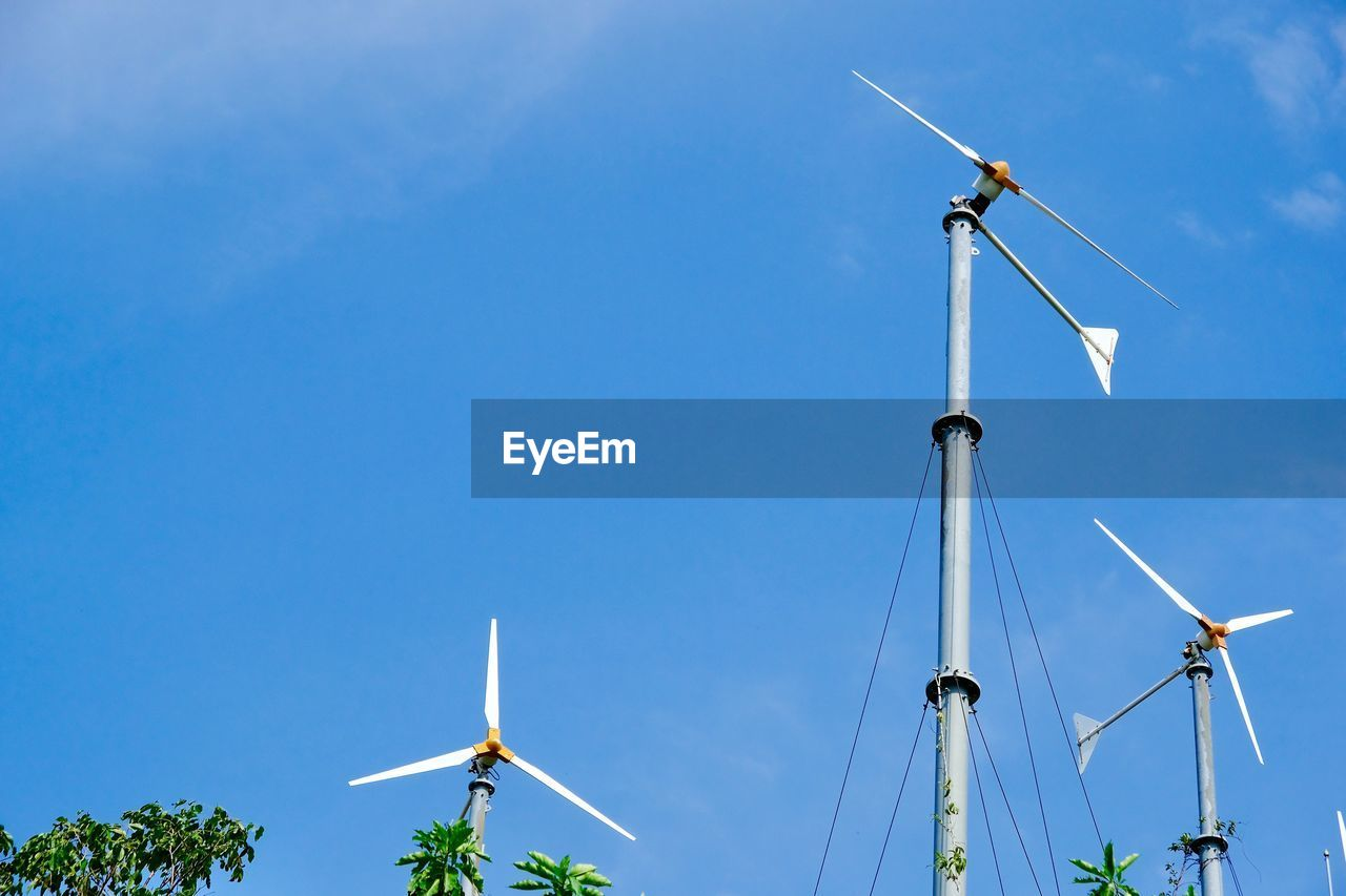 wind power, wind turbine, alternative energy, renewable energy, environmental conservation, fuel and power generation, windmill, industrial windmill, blue, low angle view, traditional windmill, technology, day, outdoors, sky, no people, nature