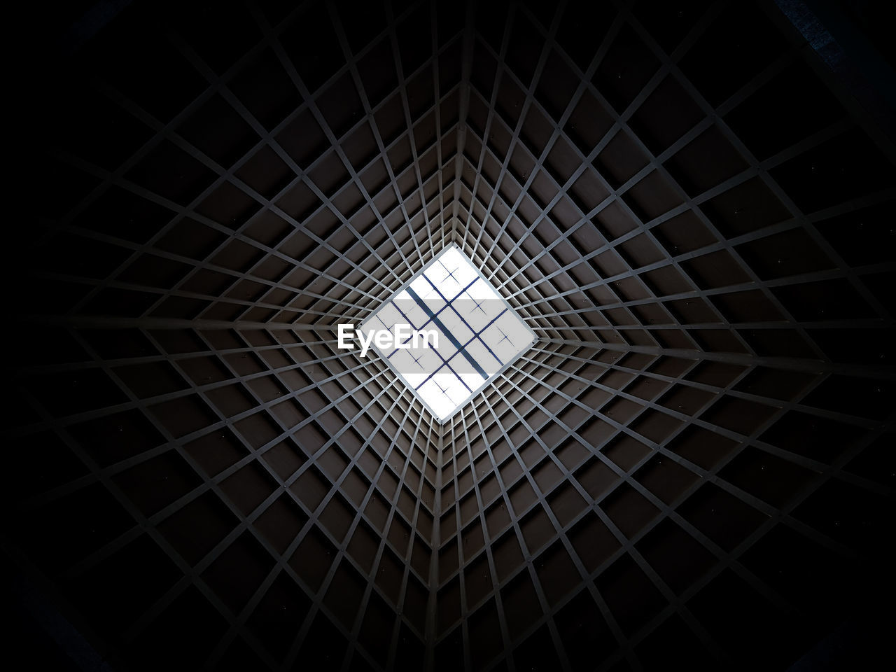 pattern, geometric shape, architecture, ceiling, indoors, shape, low angle view, built structure, directly below, design, no people, hexagon, full frame, skylight, backgrounds, window, circle, architectural feature, illuminated, square shape