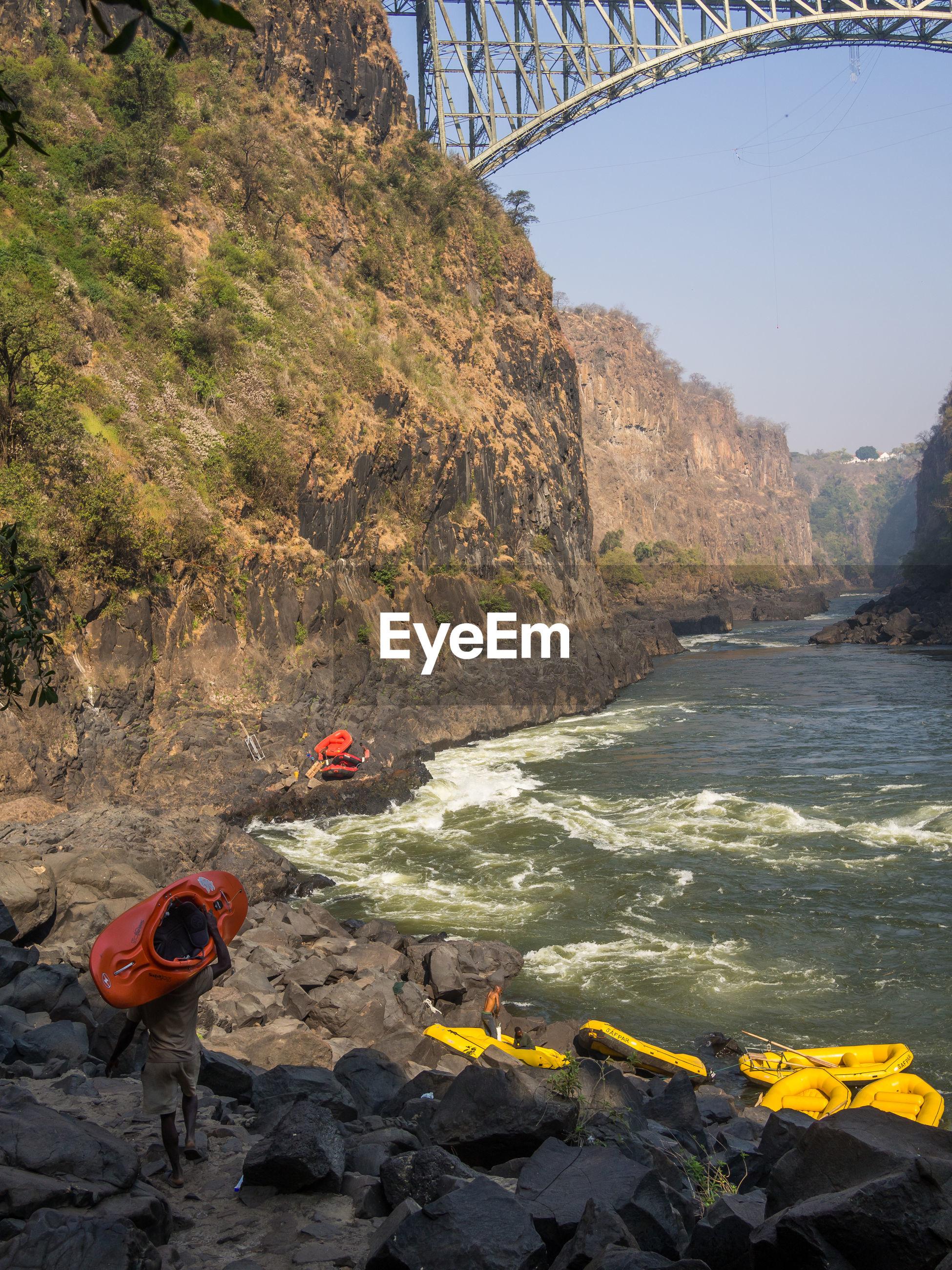 Scenic view of zambezi river, famous arch bridge and rafting at victoria falls, zambia, zimbabwe