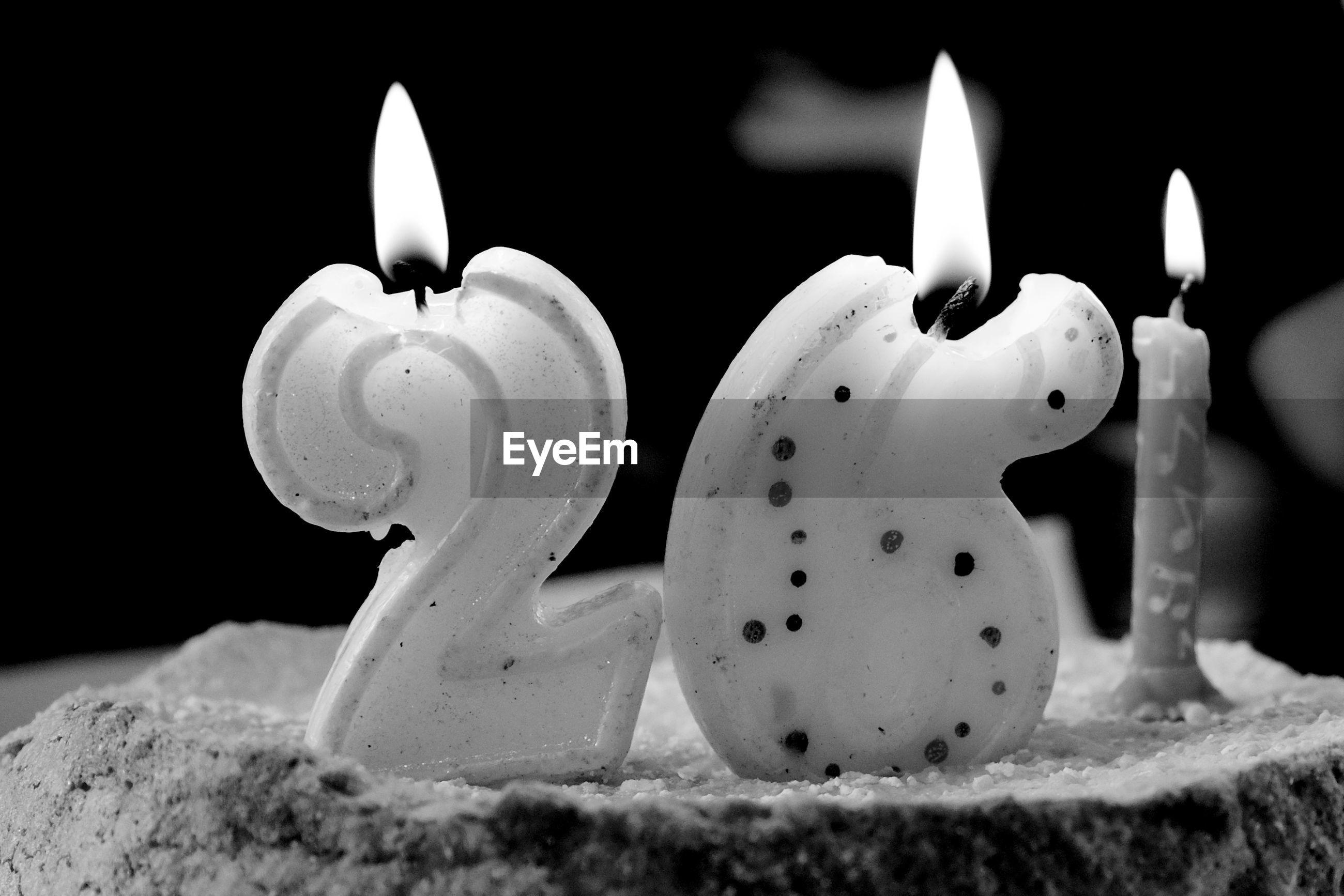 flame, candle, burning, heat - temperature, close-up, black background, melting, no people, celebration, birthday candles, birthday cake
