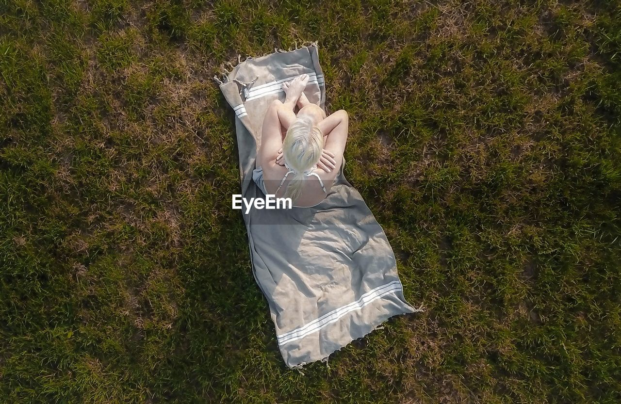 Directly Above Shot Of Woman Sitting On Picnic Blanket