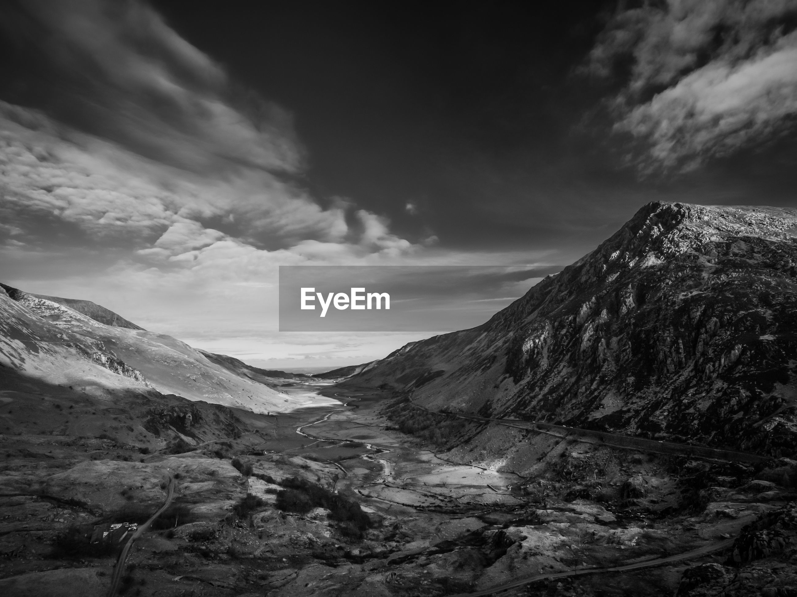Scenic view of snowdonia national park against sky