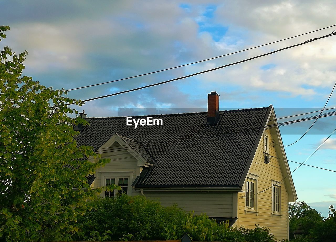 sky, architecture, low angle view, built structure, building exterior, tree, cloud - sky, no people, house, day, outdoors, cable, nature