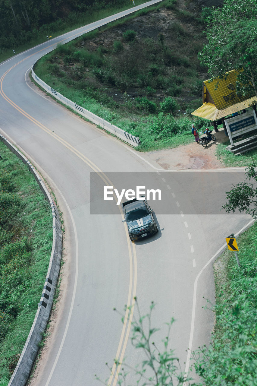 transportation, mode of transportation, road, car, motor vehicle, plant, land vehicle, high angle view, tree, nature, street, day, city, no people, sign, symbol, road marking, outdoors, travel, on the move