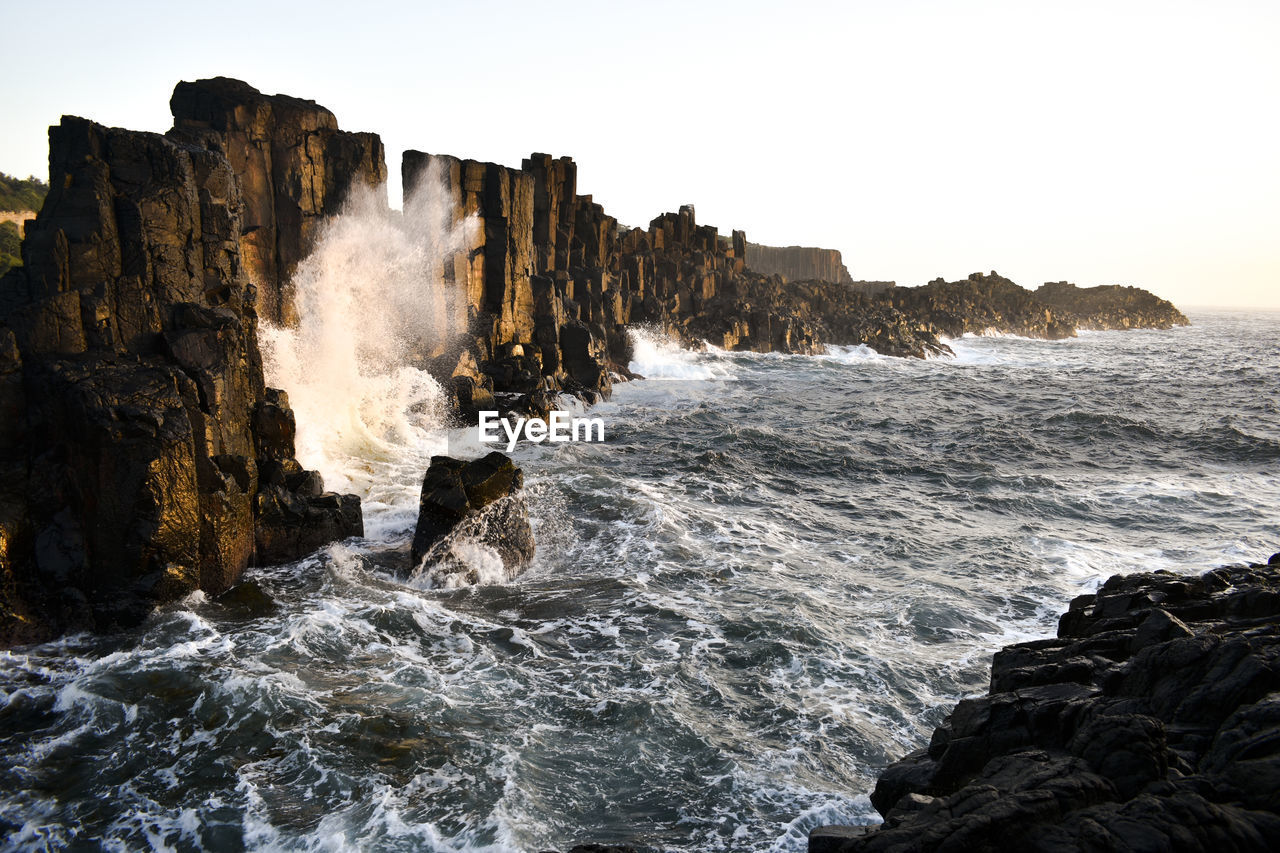 sea, water, rock, rock - object, motion, solid, sky, beauty in nature, wave, aquatic sport, sport, splashing, nature, land, scenics - nature, surfing, beach, rock formation, power, power in nature, breaking, outdoors, hitting, rocky coastline, flowing water