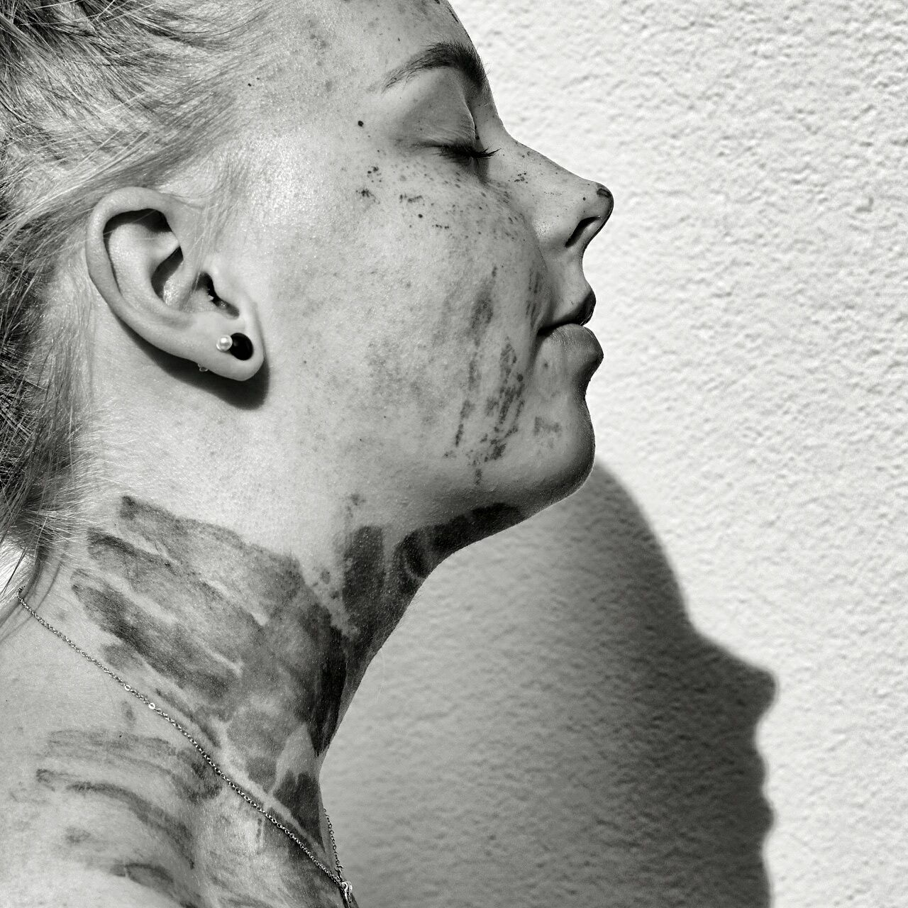 Woman with body paint against wall