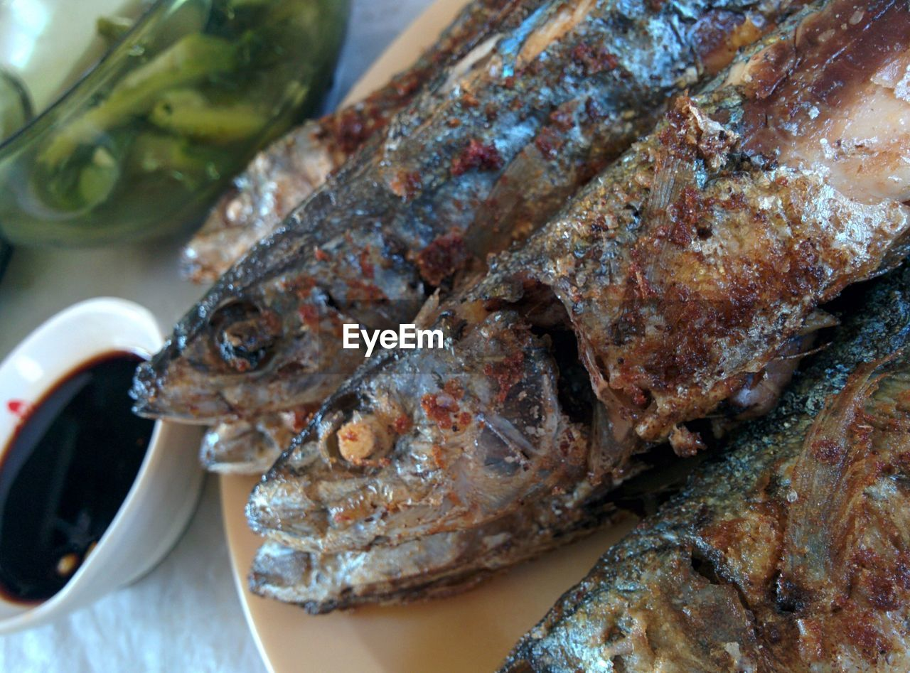High Angle View Of Fresh Fried Fish Served In Plate On Table At Restaurant