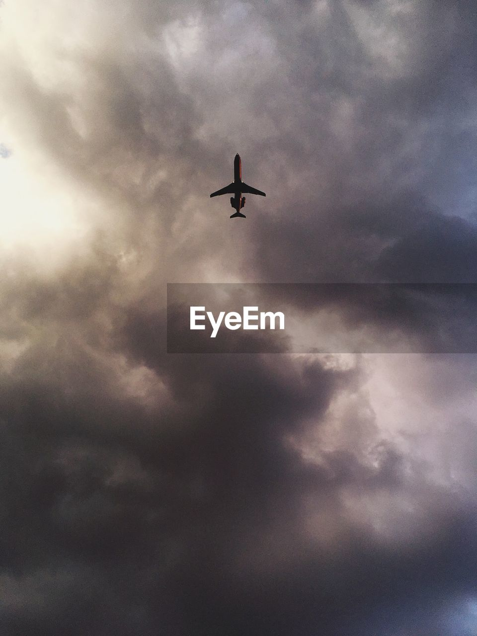 flying, sky, low angle view, cloud - sky, airplane, journey, mid-air, silhouette, outdoors, no people, transportation, air vehicle, spread wings, day, nature, bird, animal themes