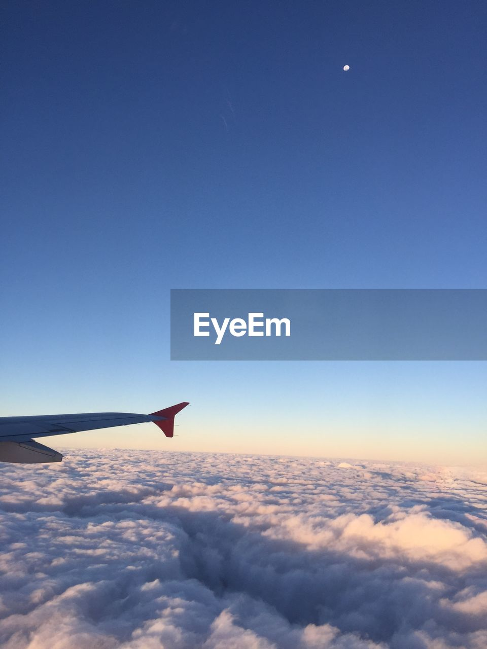 sky, airplane, air vehicle, cloud - sky, flying, mode of transportation, scenics - nature, aircraft wing, transportation, beauty in nature, travel, no people, blue, mid-air, nature, cloudscape, copy space, on the move, motion, tranquility, outdoors, meteorology