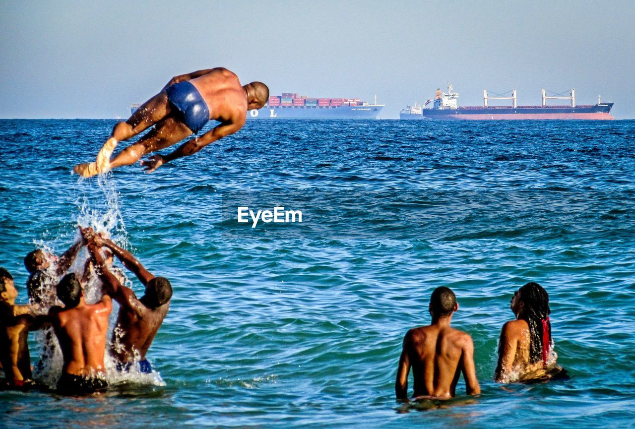 water, sea, sky, real people, leisure activity, nature, clear sky, lifestyles, togetherness, adult, people, women, day, men, shirtless, waterfront, beauty in nature, outdoors