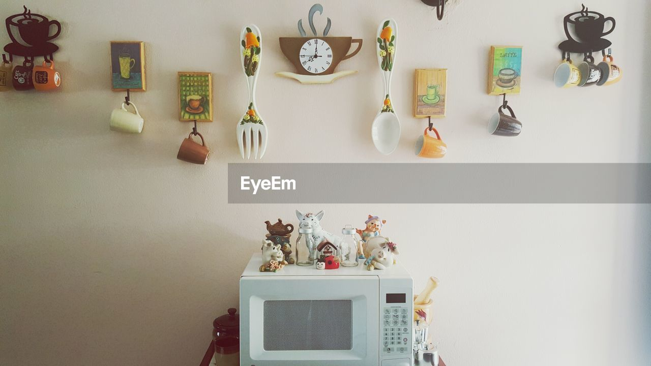 Cups And Decorations On Wall