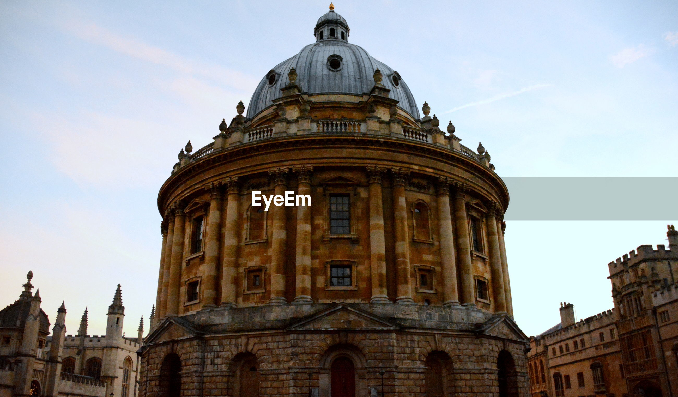 Low angle view of oxford university against sky