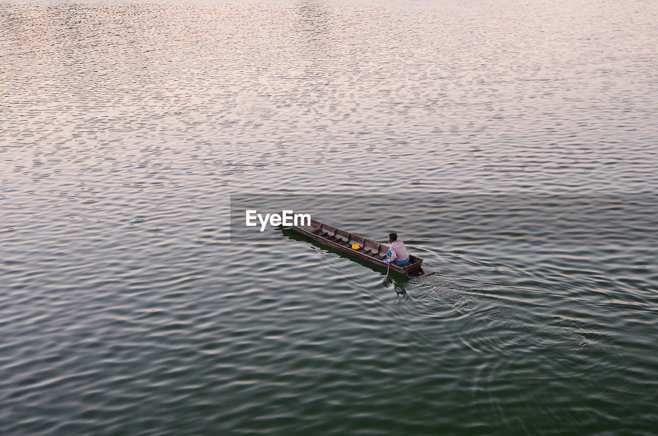 High Angle View Of Man On Boat In River