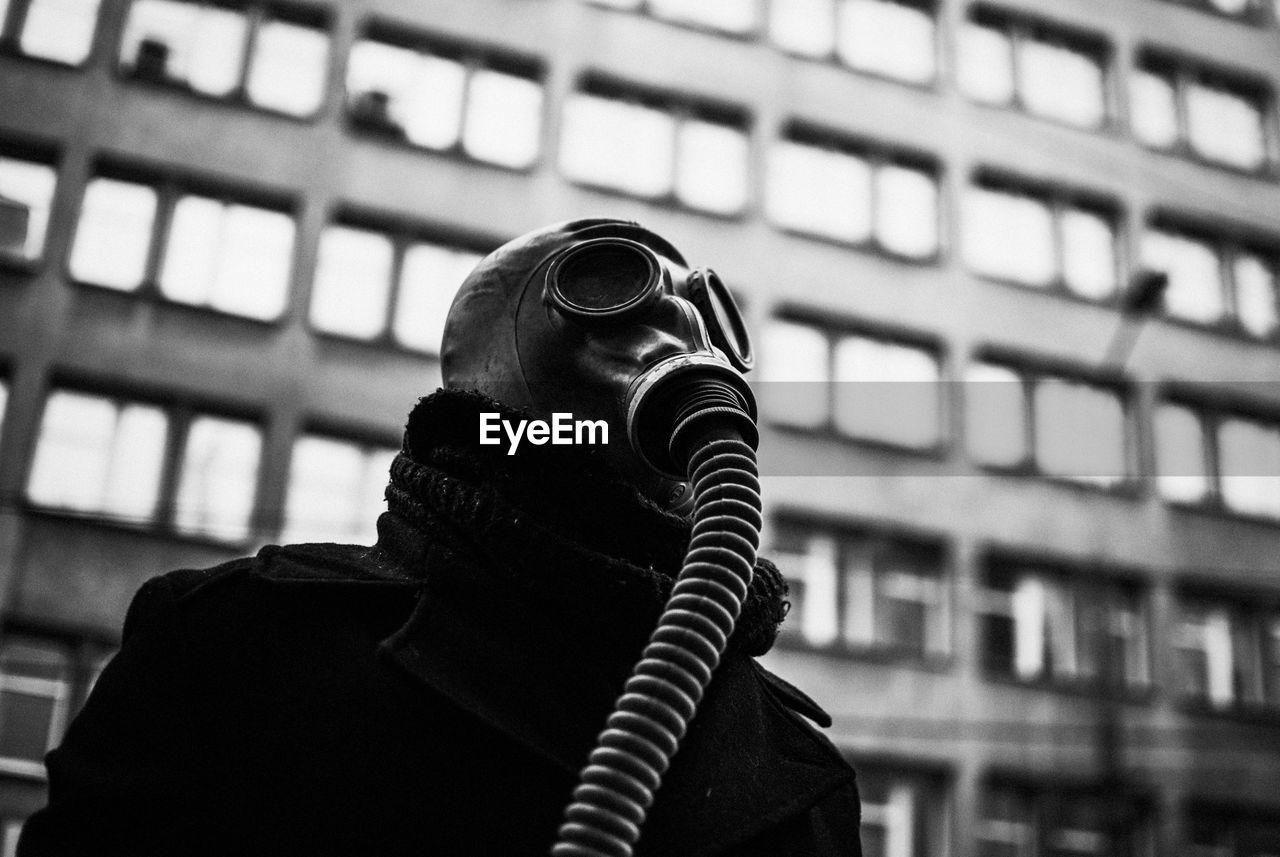 Low Angle View Of Man Wearing Gas Mask