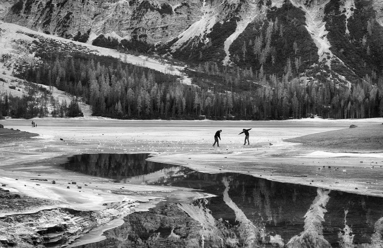 People Standing On Frozen Lake Braies