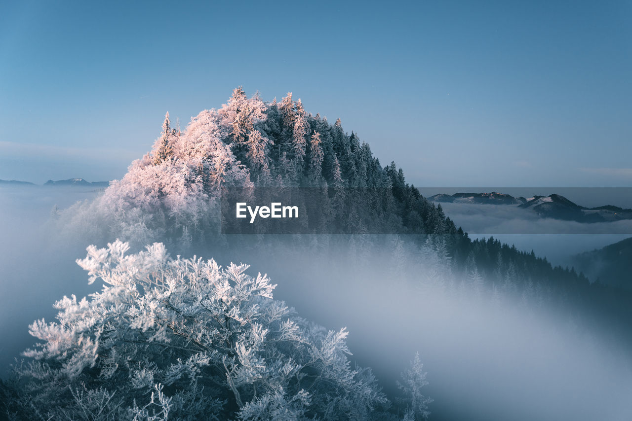 Scenic View Of Snow Covered Mountain Against Clear Sky