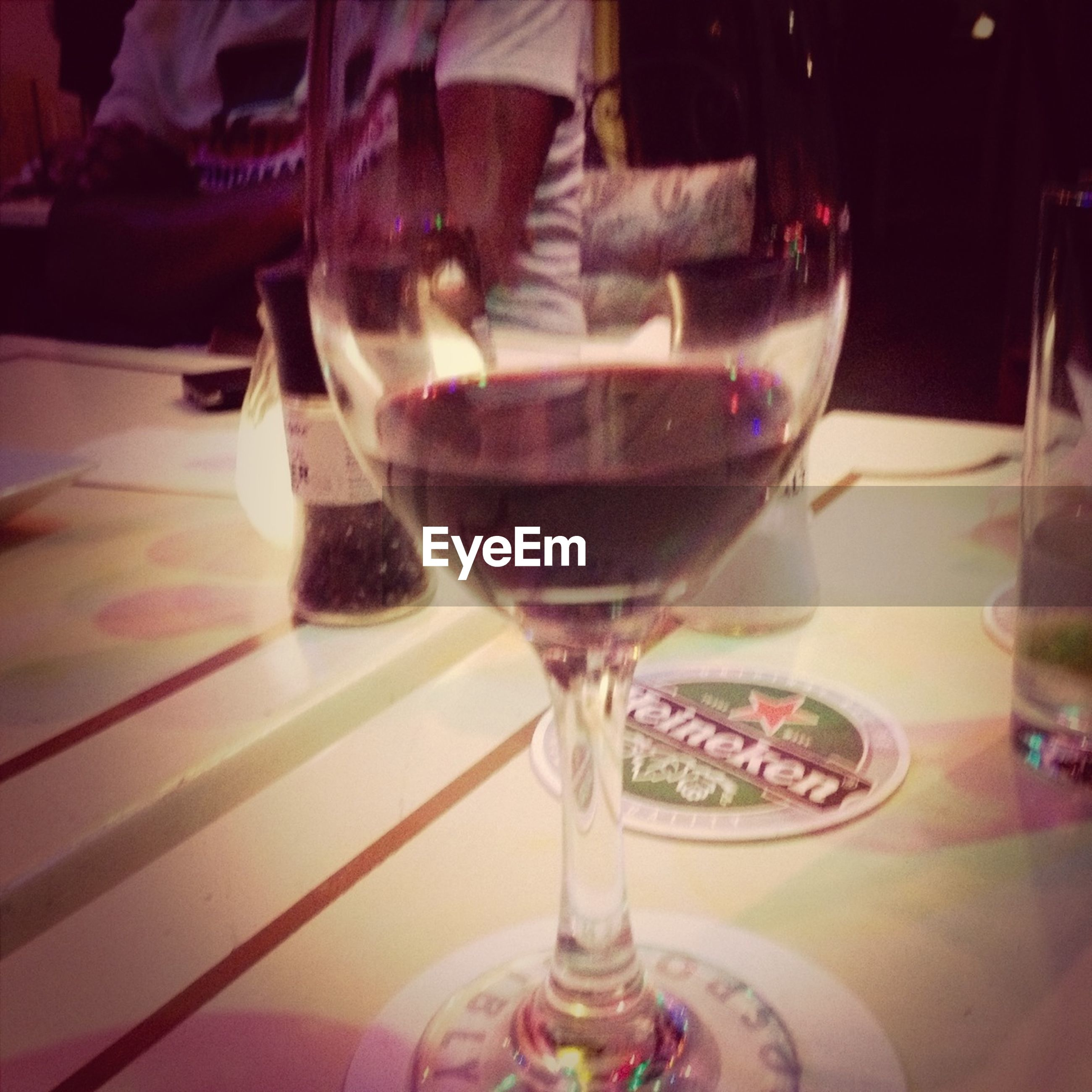 drink, indoors, drinking glass, food and drink, table, refreshment, glass - material, freshness, still life, wineglass, transparent, alcohol, close-up, restaurant, wine, focus on foreground, glass, indulgence, incidental people, red wine