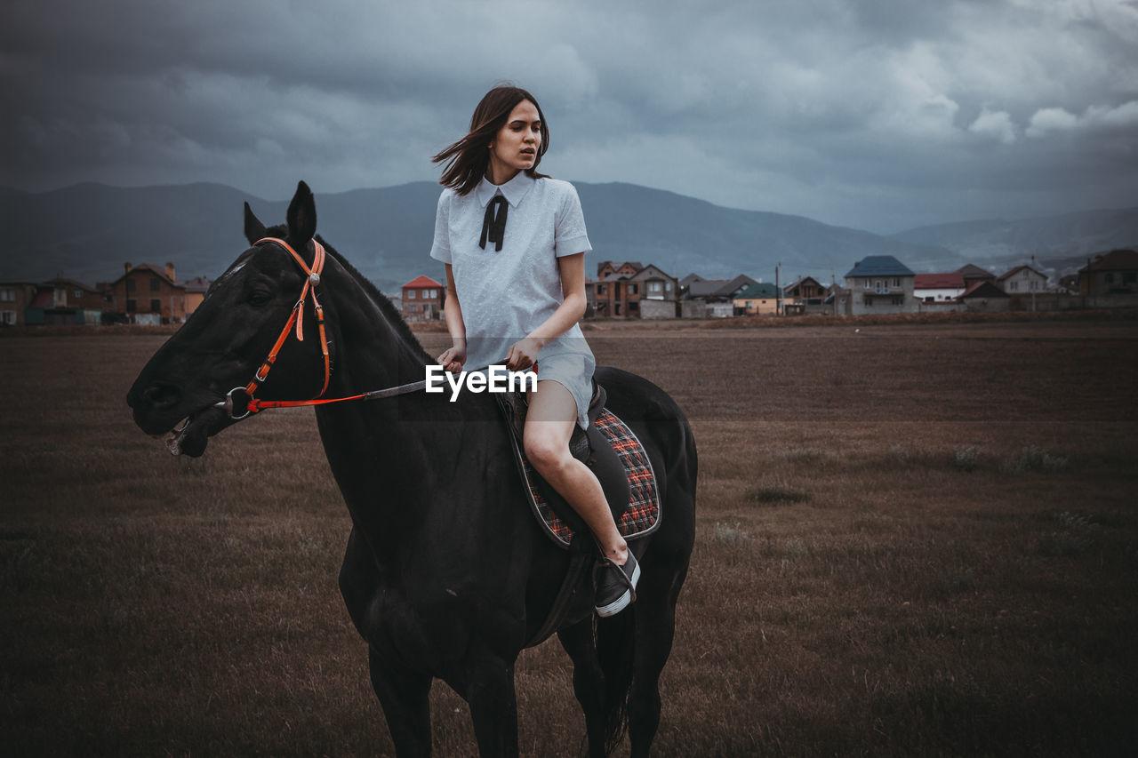 Woman On Horse In Field